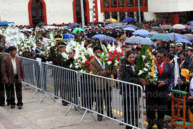 Devotees waiting to present floral tributes during central mass, Puno, Peru