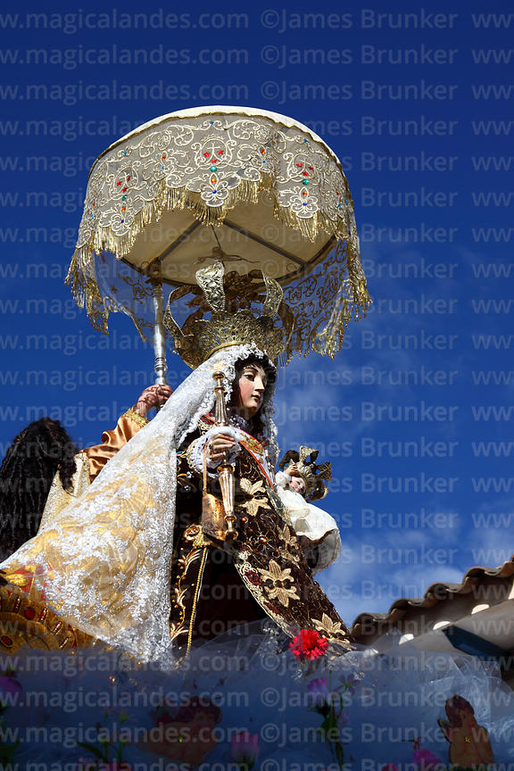 Figure of Virgen del Carmen during main procession around village , Paucartambo , Peru