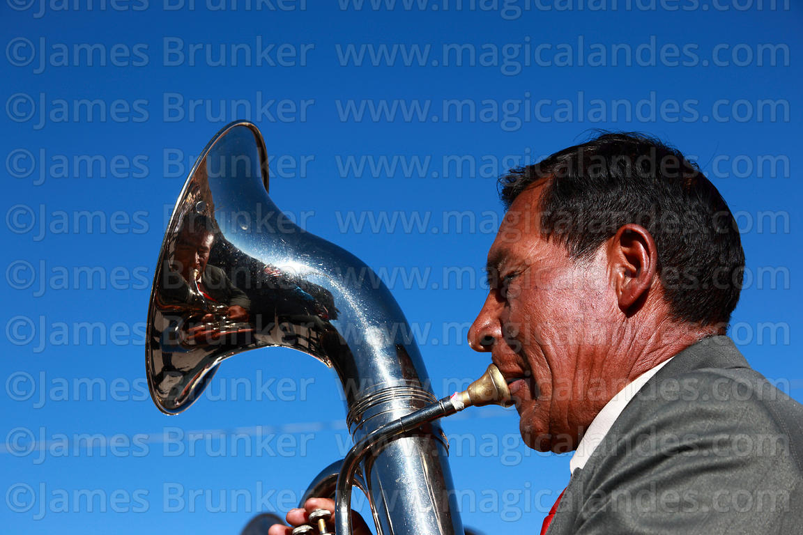 Man playing tuba in brass band, Chutillos festival, Potosí, Bolivia