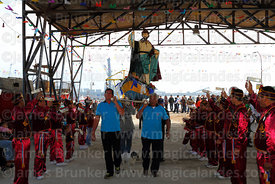 Bearers carry statue of St Peter after procession around port, St Peter and St Paul festival, Arica, Chile