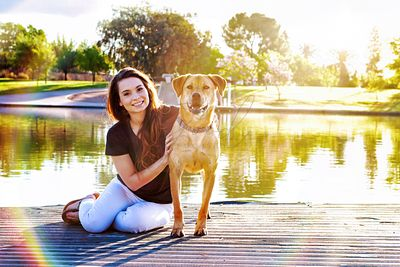 Girl and Dog at Park Sunflare