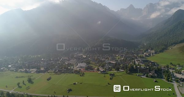 Alpine town, C4K aerial drone view away from the Kranjska Gora town and Trigolov national park, on a sunny summer day, in the...