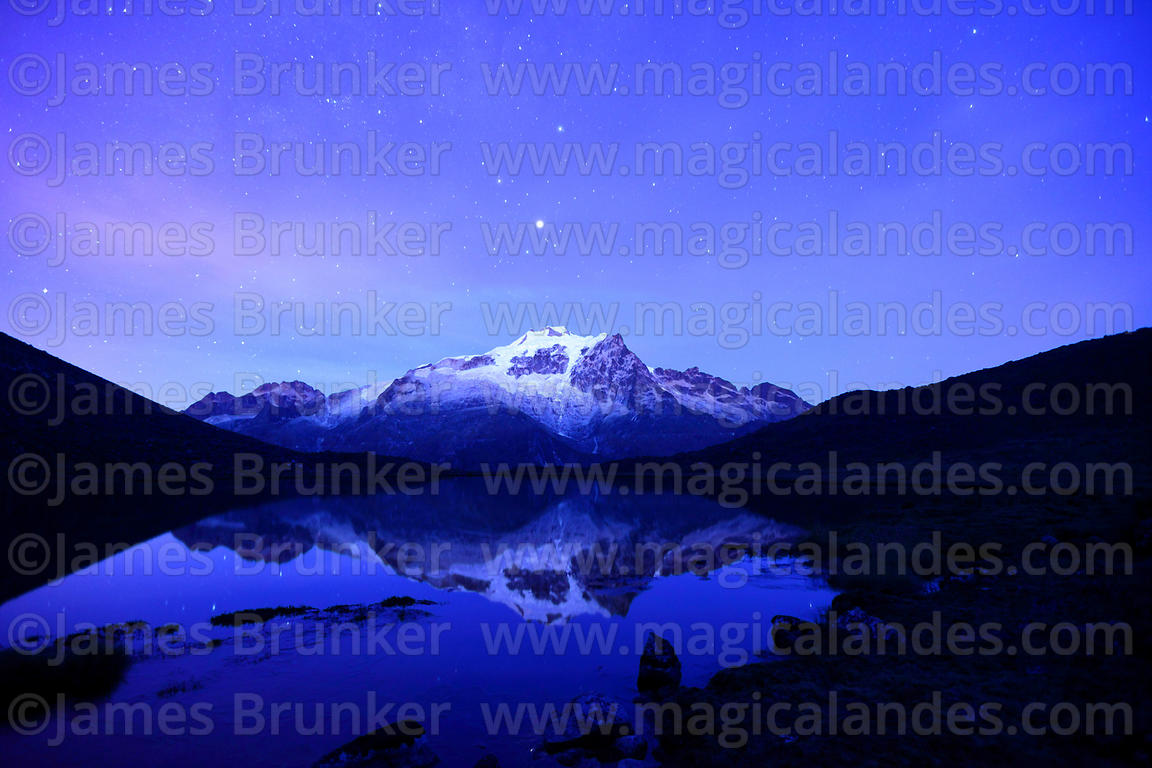 Mars shining above Mt Huayna Potosí reflected in lake before dawn, Cordillera Real, Bolivia