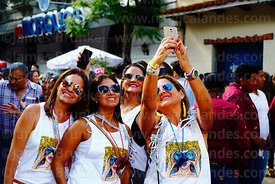 Group of friends taking a selfie during street parties for Comadres festival, Tarija, Bolivia
