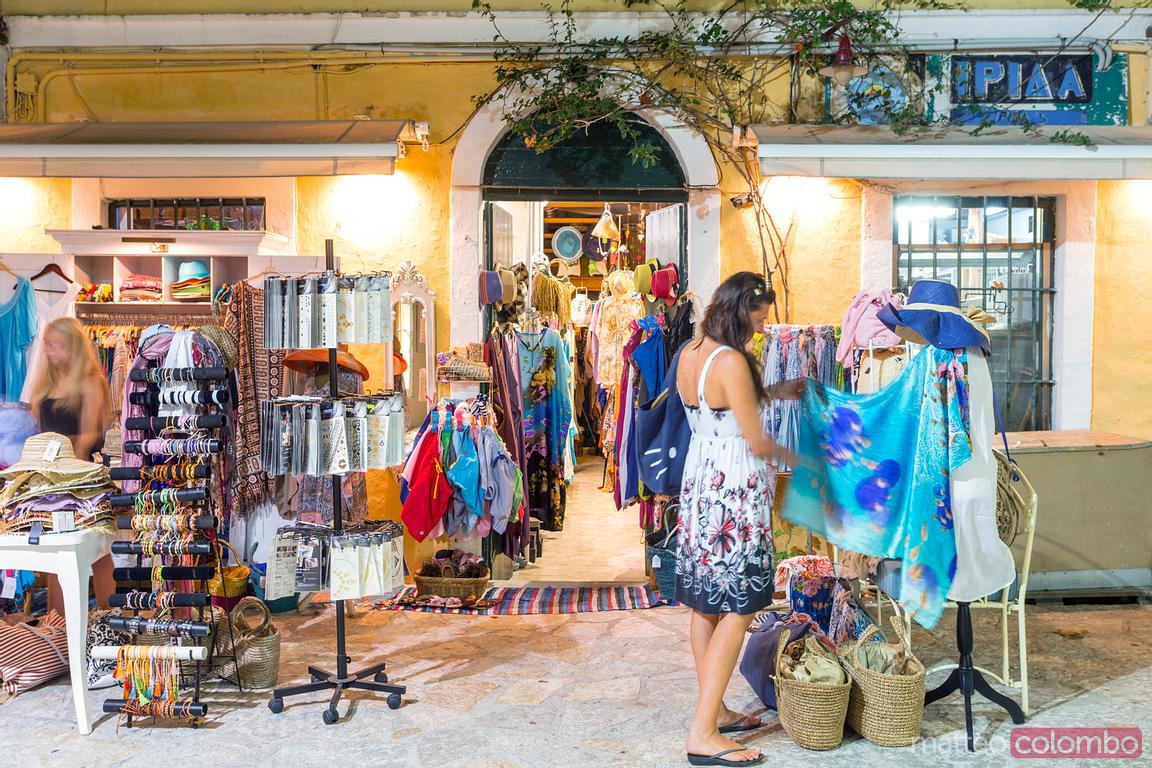 Woman shopping in a summer evening. Kefalonia, Greek Islands, Greece