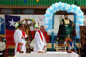 Former bishop of Arica Hector Vargas Bastides (L) and priest praying at start of mass for St Peter and St Paul festival, Arica, Chile