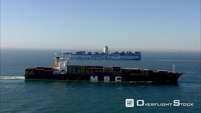 Loaded container ship in a harbor channel