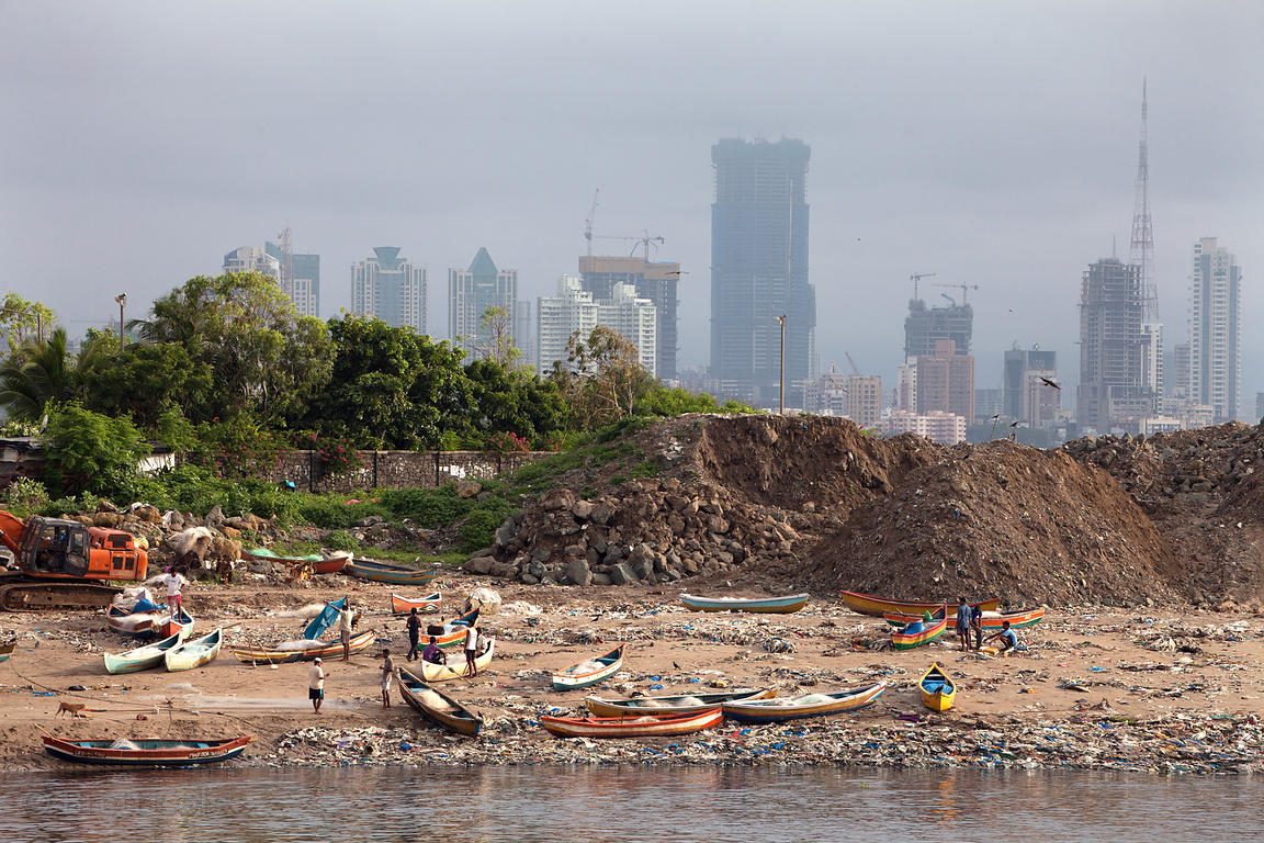 Garbage piles up near fishing boats in Mahim Bay, Mumbai, India. Mumbai's landfills are projected to fill up soon, with the m...