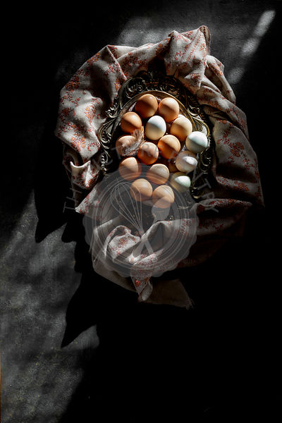 Eggs in a basket on a dark background