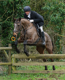 Alastair Wilson jumping a hunt jump near Knossington Spinney