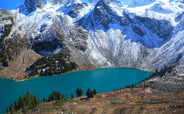 Lake Upper Multinskoe, a typical tarn lake in the sub-alpine belt of Altai Mountains with groves of Siberian pine trees  Sout...