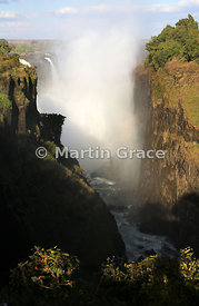 Main Falls from the west in late afternoon sun, Victoria Falls, Zimbabwe and Zambia
