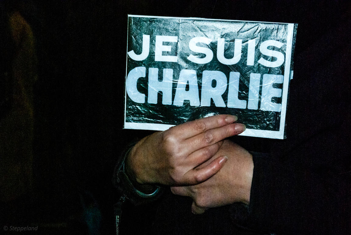 Amsterdam, Netherlands 2015-01-08: A lady's hands holding the sign: 'Je suis Charlie'.