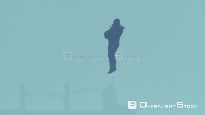 Aerial slow motion shot of a paramedic jumping into the sea from a rescue helicopter Cape Town Western Cape South Africa
