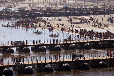Pilgrims walk across pontoon bridges on the Ganges River at the 2013 Kumbh Mela, Allahabad, India.