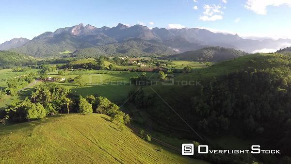 Aerial shot over an area of Atlantic Forest, showing agricultural encroachment, Reserva Ecologica de Guapiacu, Rio de Janeiro...