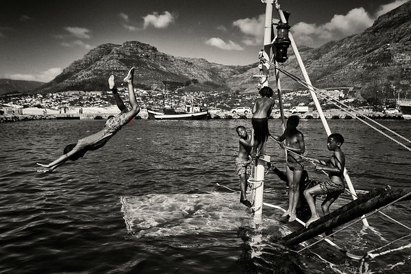 Children Playing on a Sunken Fishing Boat in Hout Bay Harbour