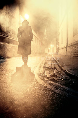 An atmospheric image of two mystery men meeting in a foggy street.