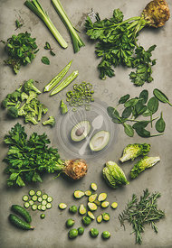 Flat-lay of whole and cut vegetables and herbs, top view