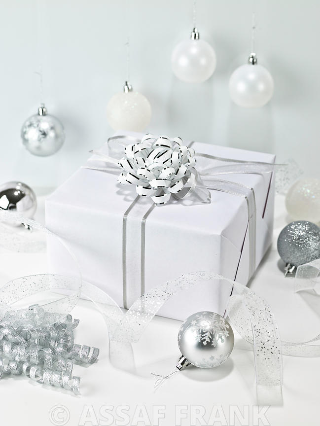 Gift box with christmas baubles