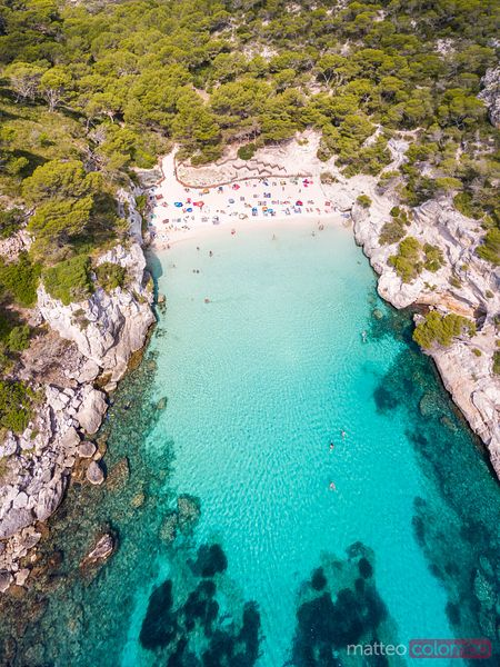 Aerial view of Cala Macarelleta beach crowded at daytime