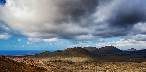 Volcanoes in Timanfaya national park, Lanarote under a cloudy sky