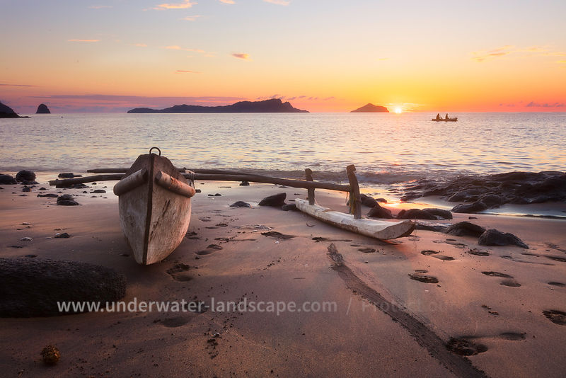 Sunset on a beach with Canoe at Moheli island