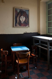 Ethiopia - Addis Ababa - A table and chairs in the Ras Makonnen coffee house