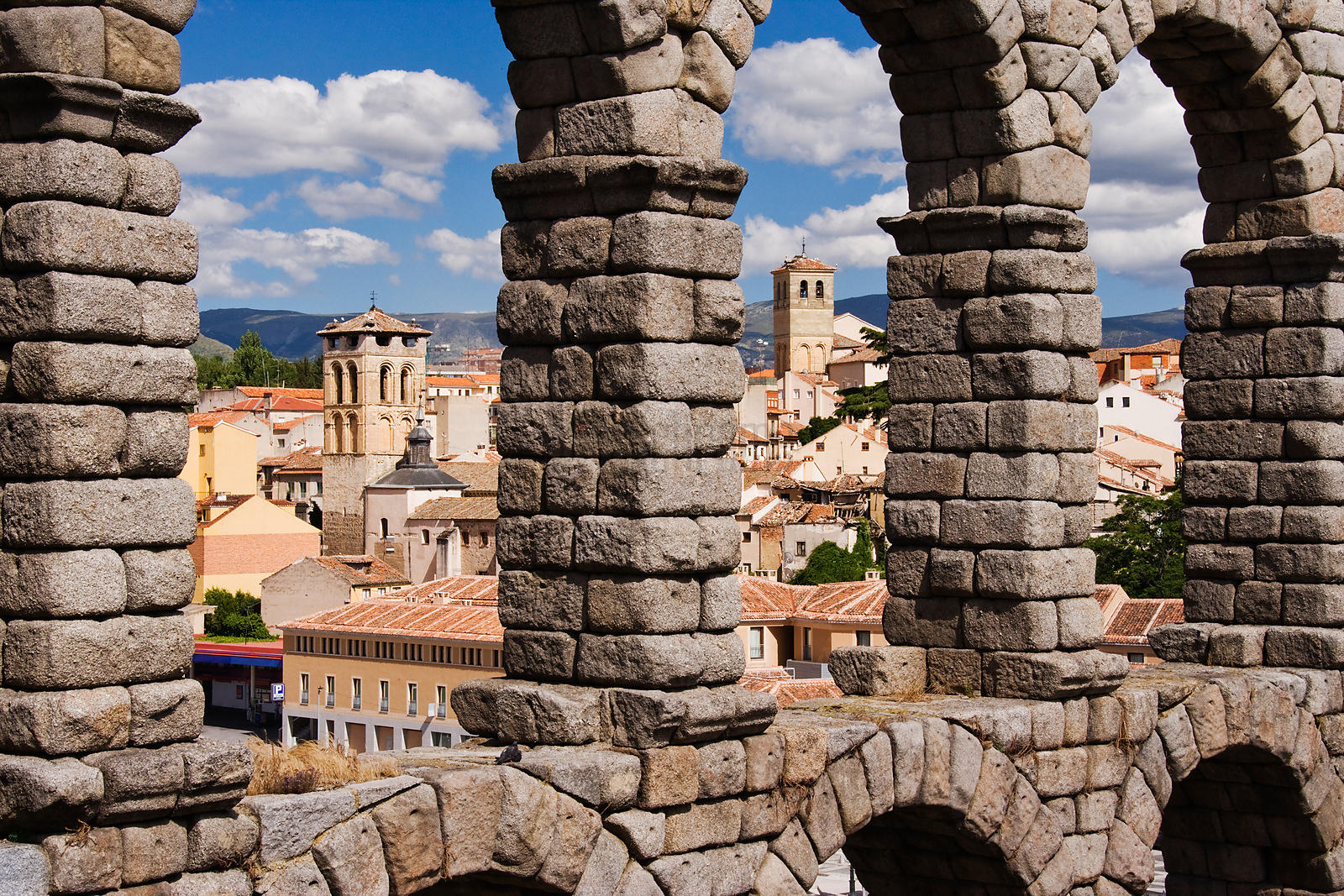 Skyline through the Roman Aqueduct Segovia Spain