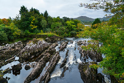 Rock erosion on river in Sneem Village, Ring of Kerry Trail, Iveragh Peninsula, County Kerry, Ireland, Europe. September 2015.
