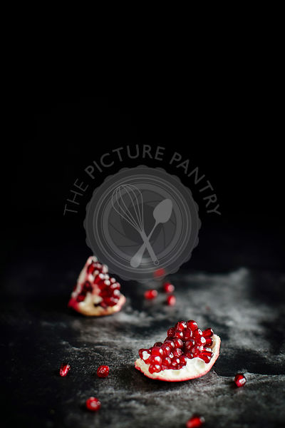 Fresh and juicy pomegranate seends on a dark background