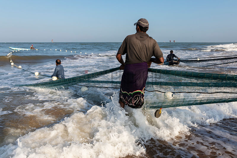 Fishermen Pulling in the Trawl Net