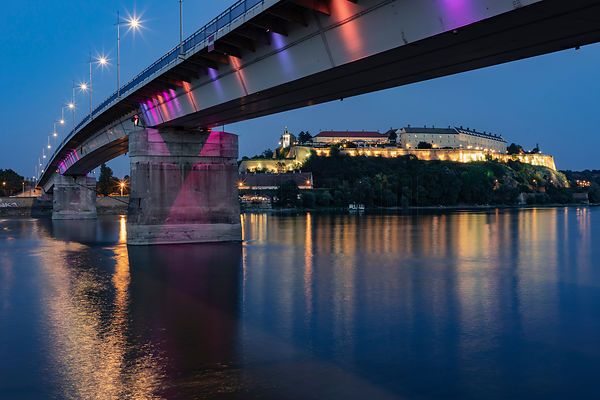View of the Petrovaradin Fortress from the Bank of the Danube River at Dusk