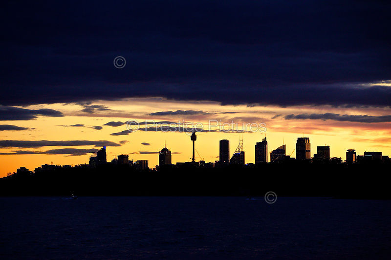 Golden Sunset across the Water to The Sydney Skyline
