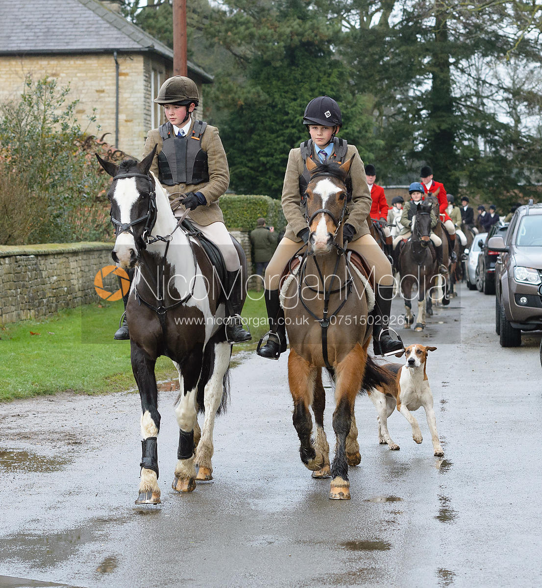 Leaving the meet - The Belvoir Hunt at Buckminster