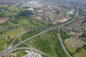 High level view across the M56 motorway Junction 5 and Airport Spur towards Farmland Roaring Gate Lane and Thorley Lane to th...