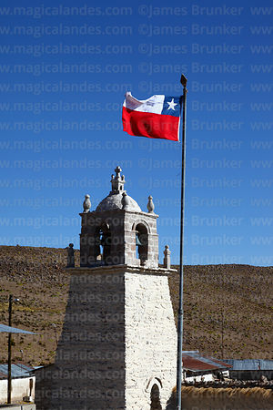Guallatiri village church bell tower and Chilean flag, Las Vicuñas National Reserve, Region XV, Chile