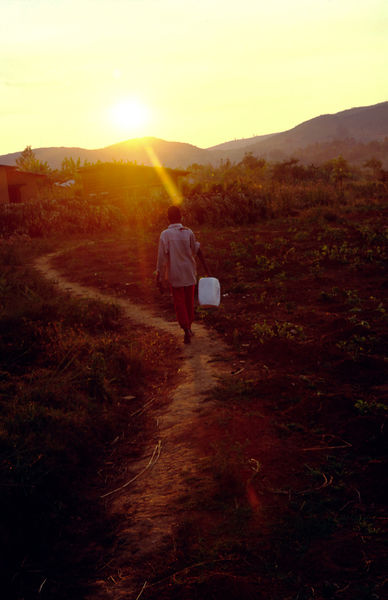 Burundi - Ruyigi - A child goes to fetch water at sunset