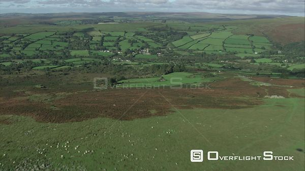 Aerial view tracking towards WidecombeintheMoor, Dartmoor National Park, Devon, England, UK, October 2015.