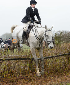 Georgie Mason jumping a hedge near Pasture Lane