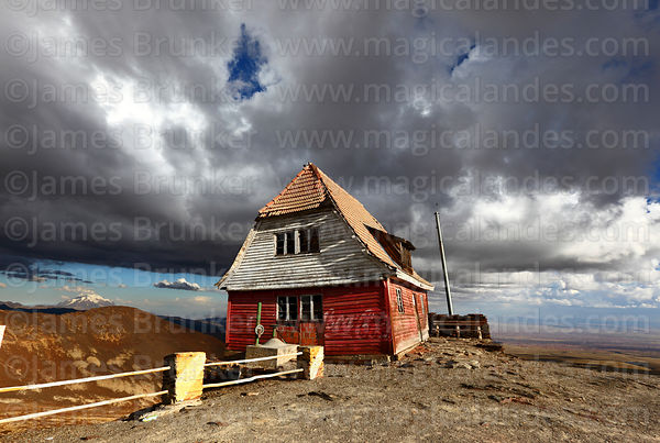 Stormy skies above the old ski hut on Mt Chacaltaya, Bolivia