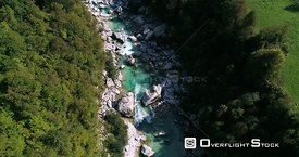 Alpine rapids, C4K aerial drone view, low over turquoise soca river, in the alp nature, near Trigolov national park, on a sun...