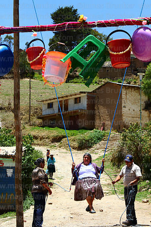 Quechua woman on a wallunk'a / swing during Todos Santos festival, Morochata, Cochabamba Department, Bolivia