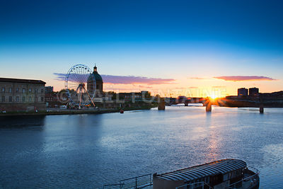 Sunset over the bridge at Toulouse city