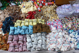 Miniature sacks of typical local food for sale on market stall, Alasitas festival, La Paz, Bolivia