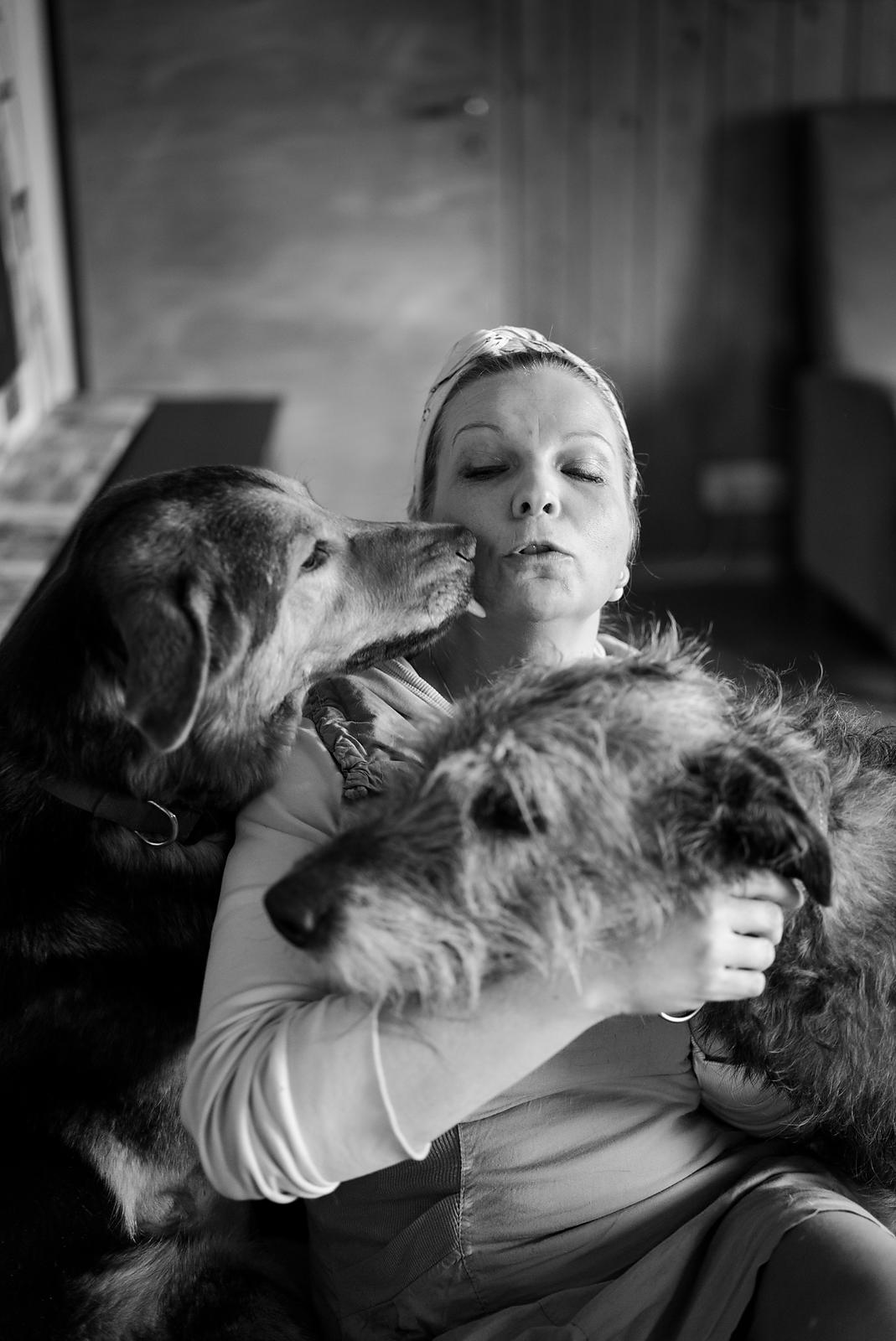 Dog behaviourist Kati Rättö at her home with two of her 13 dogs.