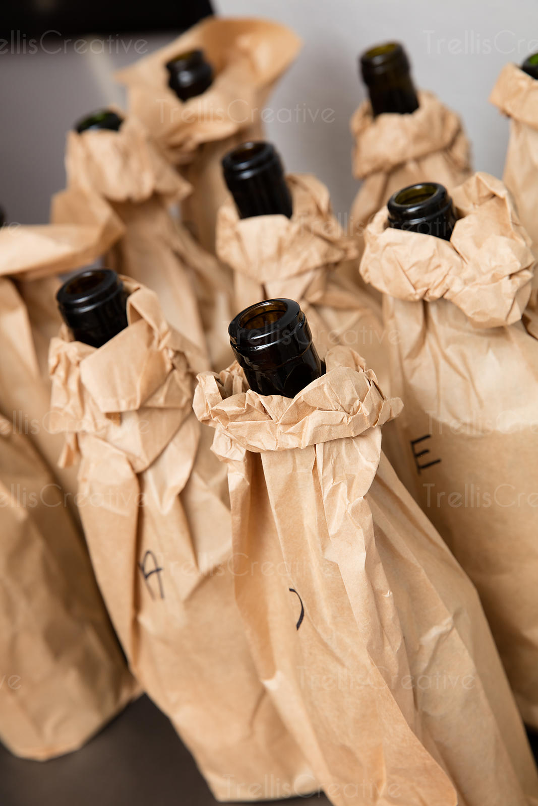 Wine bottle wrapped with in brown bags
