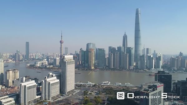 Shanghai Skyline at Sunny Day. Lujiazui Business District and Huangpu River. Blue Clear Sky. China. Aerial View. Drone is Fly...