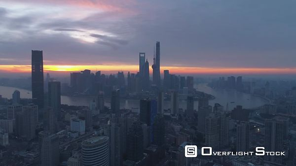 Shanghai Skyline at Dawn. Panoramic Aerial View. China. Drone is Flying Backward. Establishing Shot.