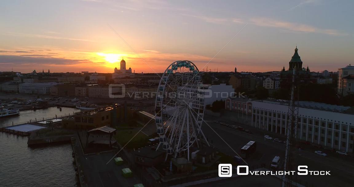 Sunset City, Aerial Tilt View of the Helsinki Skywheel Ferris Wheel and the Market Square and South Harbour, on a Sunny Summe...